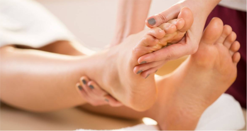 Massage-your-feets-to-Strengthen-Weak-and-Tired-Legs